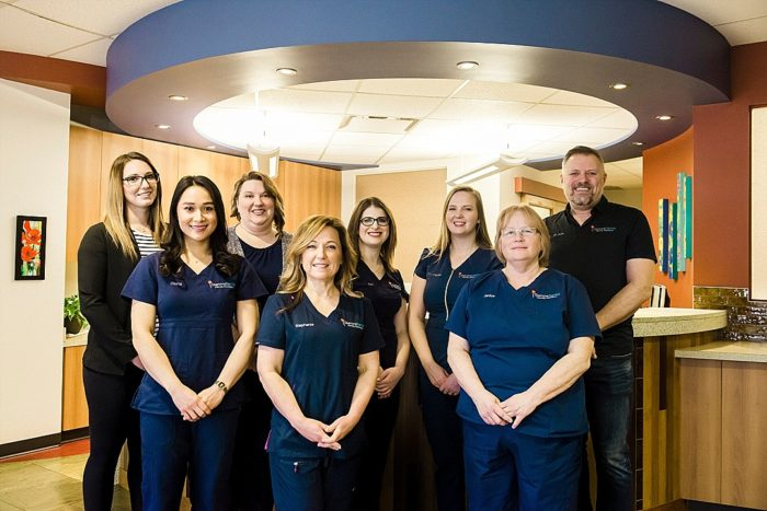 Professional photo of a team working for a dental office