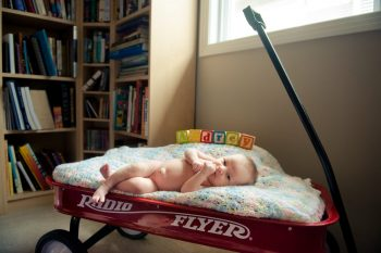 Baby in a wagon in the home library