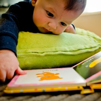 Baby reading a board book