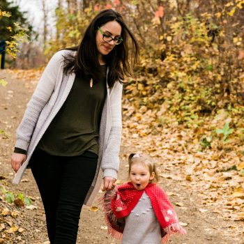 Baby looks surprised walking with Mom in Gold Bar Park