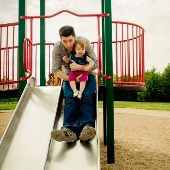 Candid lifestyle Family photos at Park slide with Dad and young girl