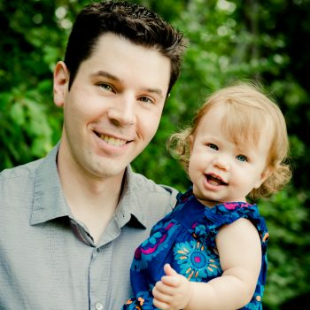 Dad with smiling baby in river valley forest Edmonton