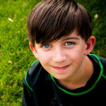 Young boy smiles in Sherwood Park