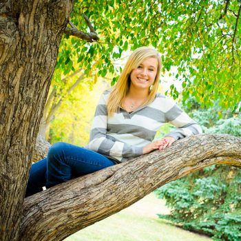 Girl sits in a tree in south Edmonton