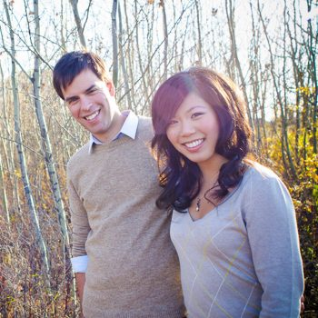 Candid lifestyle photo of a couple in front of a forest in Callingwood, Edmonton