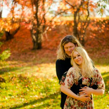 Fall Couples portrait with brilliant foliage