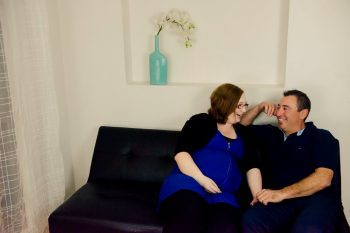 Maternity photo of couple on the couch