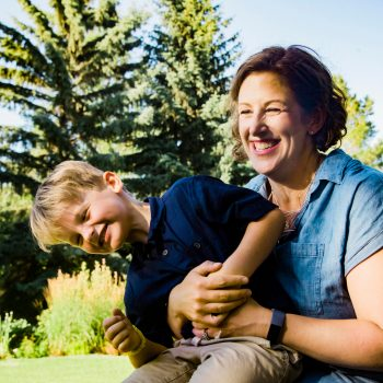 Photo of mother and laughing young son at Muttart Conservatory Gardens