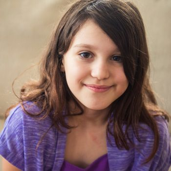 Young girl wearing purple indoors for children's portraits