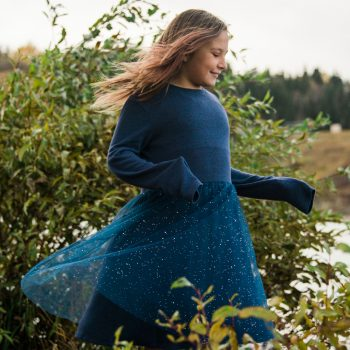Young girl twirling beside the Whitemud Ravine