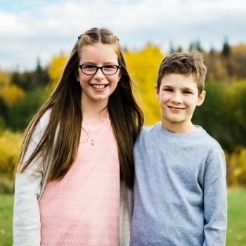 Siblings smiling and hugging at Rundle Park Family Centre