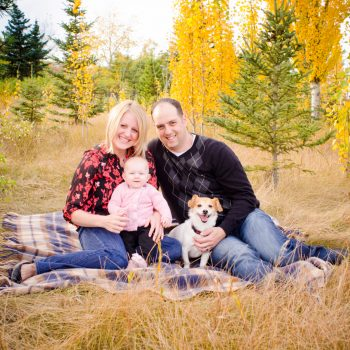 Family of three with their dog on a picnic blanket in Rundle Park