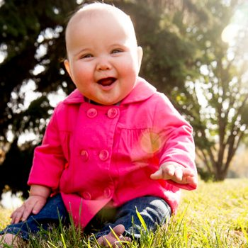 Laughing baby at Rundle Park in Edmonton