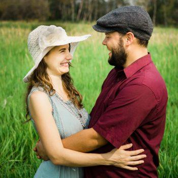 Couple slow dancing on an acreage field