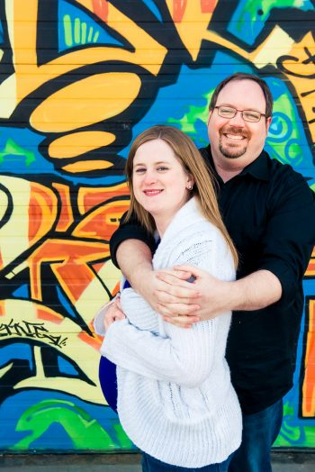 Pregnant Couple in front of a grafitti wall