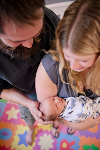 Unique photo of a couple with their newborn